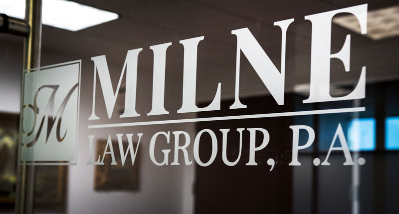 Milne Law Group signage on glass